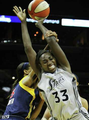 San Antonio SilverStars' Sophia Young (33) gets fouled by Indiana Fevers' Tangela Smith (05) in the second half at the AT&T Center in San Antonio  on Tuesday, August 16, 2011. Silverstars lose to the Fever, 63-65. Kin Man Hui/kmhui@express-news.net Photo: KIN MAN HUI, -- / San Antonio Express-News