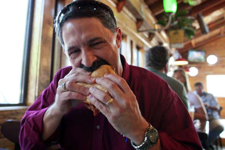 Tookie's burger restaurant in Seabrook makes a lot of burgers, and one of the most popular is The Squealer, which has the bacon mixed right into the patty. Carnivores all across Houston mourned the Tookie's closure after Hurricane Ike in 2008, and then celebrated when the restaurant reopened in 2011.  Photo: Nathan Lindstrom, Freelance / ©2011 Nathan Lindstrom