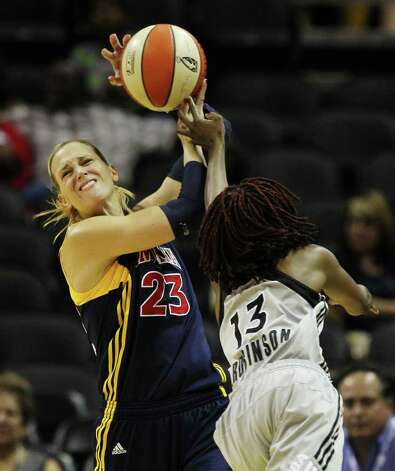 Indiana Fevers' Katie Douglas (23) keeps the ball away from San Antonio SilverStars' Danielle Robinson (13) in the first half at the AT&T Center in San Antonio  on Tuesday, August 16, 2011. Kin Man Hui/kmhui@express-news.net Photo: KIN MAN HUI, -- / San Antonio Express-News