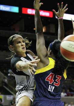 San Antonio SilverStars' Becky Hammon (25) makes a pass around Indiana Fevers' Shyra Ely (43) in the first half at the AT&T Center in San Antonio  on Tuesday, August 16, 2011. Kin Man Hui/kmhui@express-news.net Photo: KIN MAN HUI, -- / San Antonio Express-News
