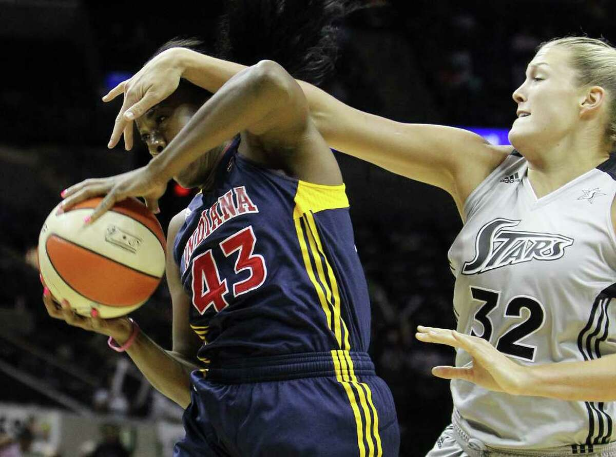 Indiana Fevers' Shyra Ely (43) grabs a rebound and gets a hand to the face by San Antonio SilverStars' Jayne Appel (32) in the first half at the AT&T Center in San Antonio on Tuesday, August 16, 2011. Kin Man Hui/kmhui@express-news.net