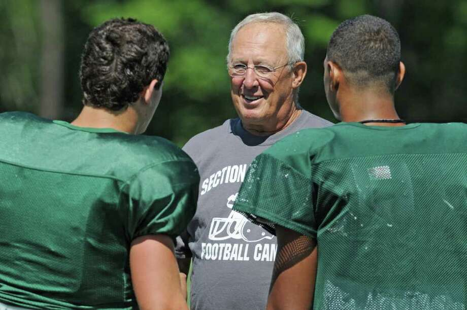 Shenendehowa High School football coach Brent Steuerwald talks a couple of his players at practice in Clifton Park, NY on August 26, 2010. (Lori Van Buren / Times Union) Photo: Lori Van Buren / 00009966A