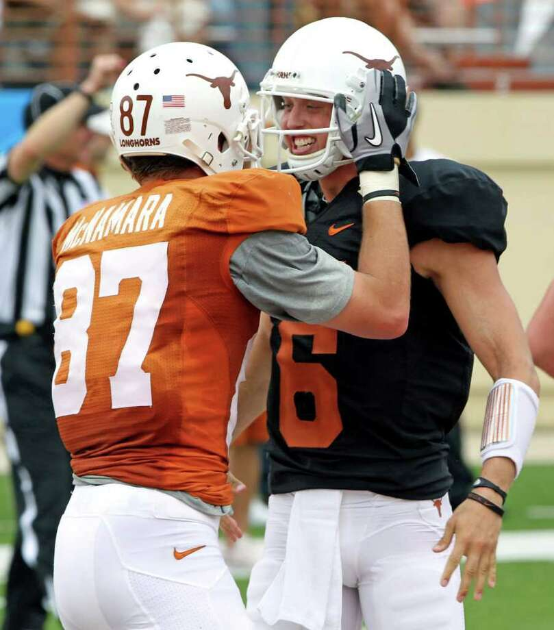 Case McCoy (right), celebrating a spring game TD pass with Patrick McNamara, is one of four QBs battling for the starting job. Photo: Michael Thomas/Associated Press