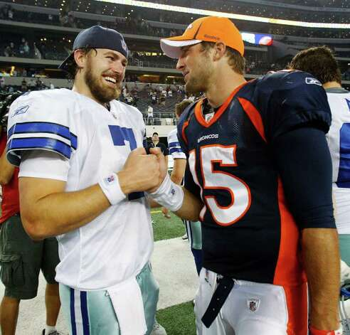 Dallas Cowboys quarterback Stephen McGee, left, and Denver Broncos quarterback Tim Tebow talks after a preseason NFL football game Thursday, Aug. 11, 2011, in Arlington. Photo: L.M. Otero/Associated Press