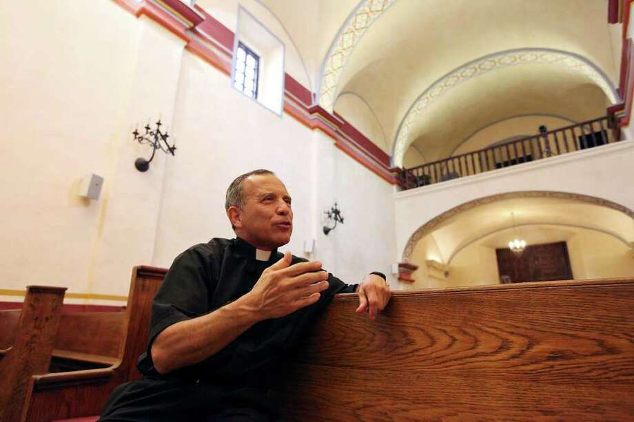 Father David Garcia talks about Mission San Jose Monday Aug. 15, 2011 during a tour. Photo: EDWARD A. ORNELAS, Edward A. Ornelas/Express-News / © SAN ANTONIO EXPRESS-NEWS (NFS)