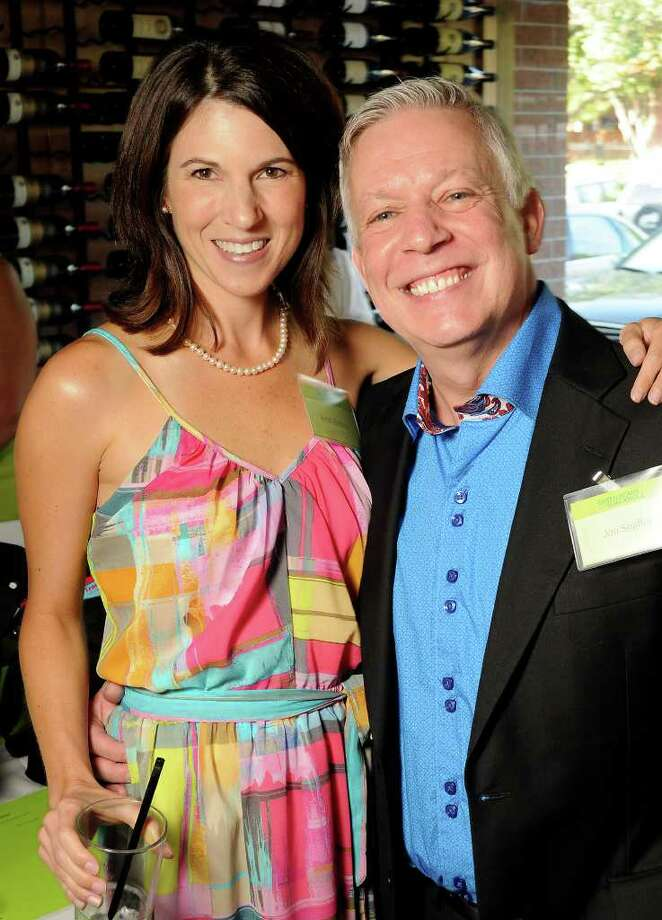 Krisiti Breaux and Jon Shaffer were among the crowd at Sorrel Urban Bistro in Upper Kirby for a fundraiser benefiting ARC, a charity for people with intellectual disabilities. Organizers sold copies of a new cookbook called Green Beans & Guacamole and held a silent auction. Photo: Dave Rossman, For The Chronicle / © 2011 Dave Rossman