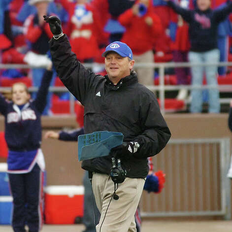 West Brook head football coach Craig Stump celebrates the Bruins 26-21 playoff upset over Fort Bend Hightower at Galena Park ISD Stadium.  Saturday, November 21, 2009. Valentino Mauricio/The Enterprise Photo: Valentino Mauricio / Beaumont