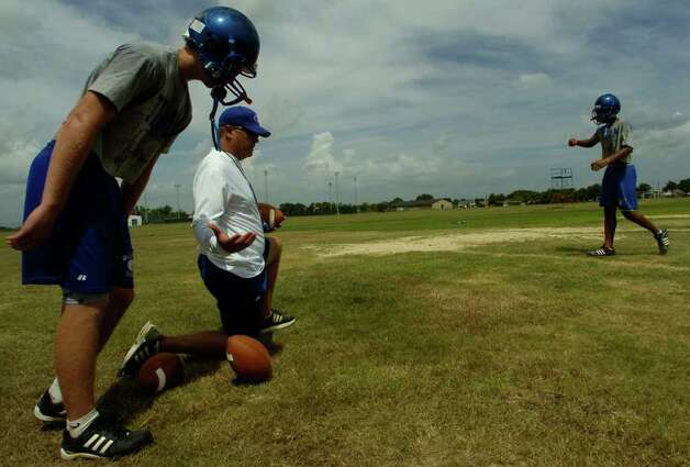 Craig Stump, middle, Head Football coach at West Brook Senior High School, gives directions to  one his players  during the first official practice Monday morning.  Dave Ryan/The Enterprise Photo: Dave Ryan / Beaumont