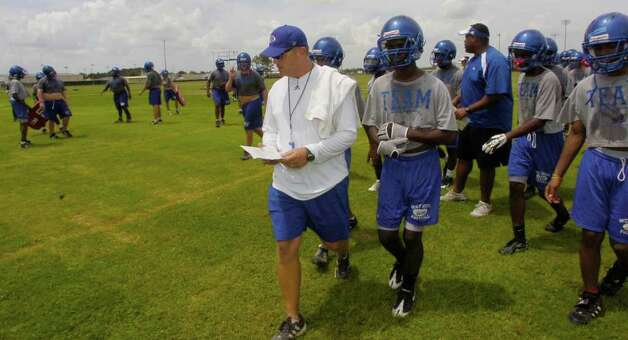 Craig Stump, middle, Head Football coach at West Brook Senior High School, gives directions to his players  during the first official practice Monday morning.  Dave Ryan/The Enterprise Photo: Dave Ryan / Beaumont
