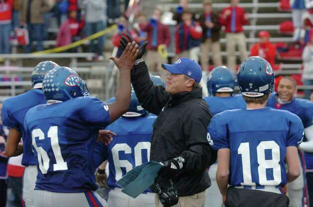 West Brook head football coach Craig Stump gets a high-five from Keithshaun Davis after the Bruins 26-21 playoff upset over Fort Bend Hightower at Galena Park ISD Stadium.  Saturday, November 21, 2009. Valentino Mauricio/The Enterprise Photo: Valentino Mauricio / Beaumont