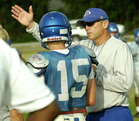 Spring football practice was held at the West Brook High School practice field Wednesday afternoon.  The team practiced many running plays with Head Coach Craig Stump, right, calling the plays to his son Josh Stump, left.   Dave Ryan/The Enterprise Photo: Tammy McKinley