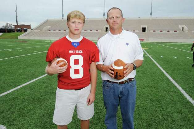 West Brook's starting quarterback Josh Stump, left,  photographed with his father, West Brook head football coach Craig Stump at Lamar University Provost Umphrey Stadium. Friday July 29 ,2011 Valentino Mauricio/The Enterprise Photo: Valentino Mauricio