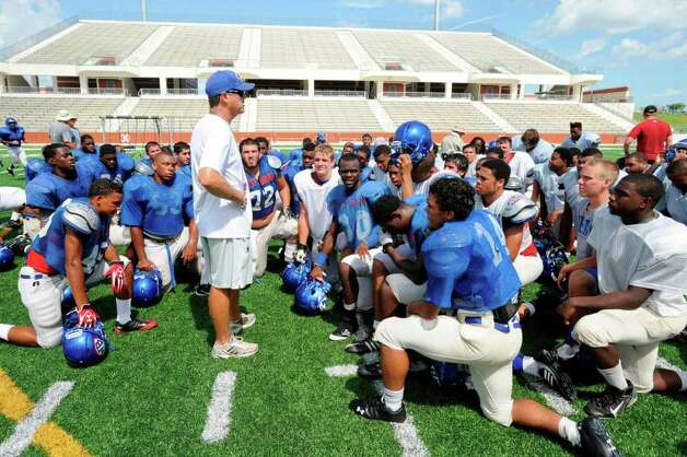 West Brook head football coach Craig Stump, left, talks with his team after the Bruins first practice session of the day on Friday at the  Carrol A. Butch Thomas Educational Support Center.   August 12, 2011.  Valentino Mauricio/The Enterprise Photo: Valentino Mauricio