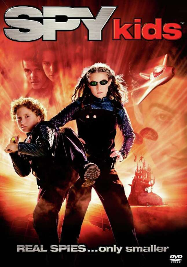 "Watch out for flying spies. A scene in ""Spy Kids"" shows the main characters taking off from Milam Park and flying down Houston Street.  Photo: Courtesy Photo"