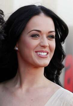 "FILE - In this April 19, 2011 file photo, singer Katy Perry arrives for the European premiere of ""Arthur"" at the O2 Arena in London. Perry leads the MTV Video Music Award nominations with nine, including video of the year for her song ""Firework."" Photo: AP"