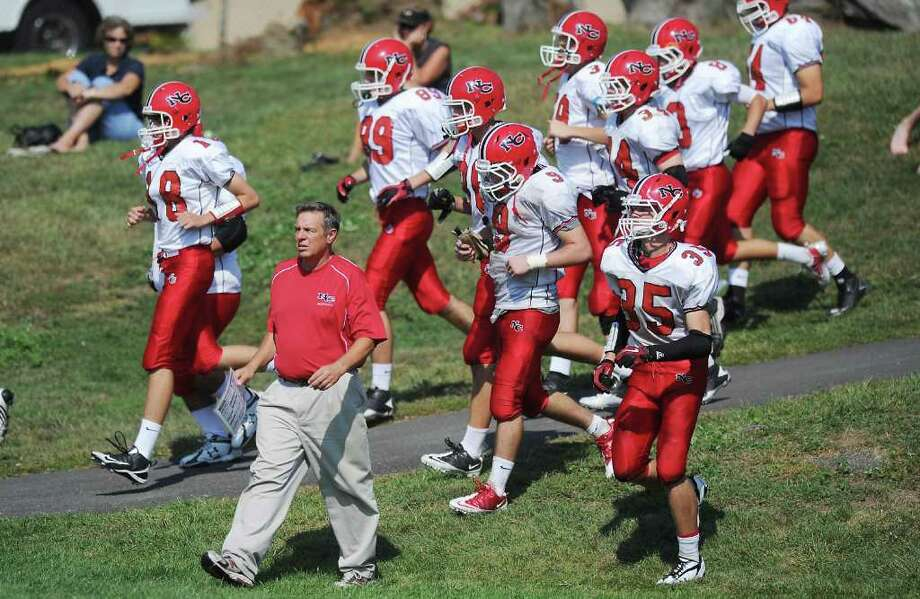 Head Coach Lou Marinelli returns to the field after half-time with the New Canaan High School football team as they take on Trinity Catholic High School in Stamford, Conn. on Saturday September 25,  2010 Photo: Kathleen O'Rourke, ST / New Canaan News