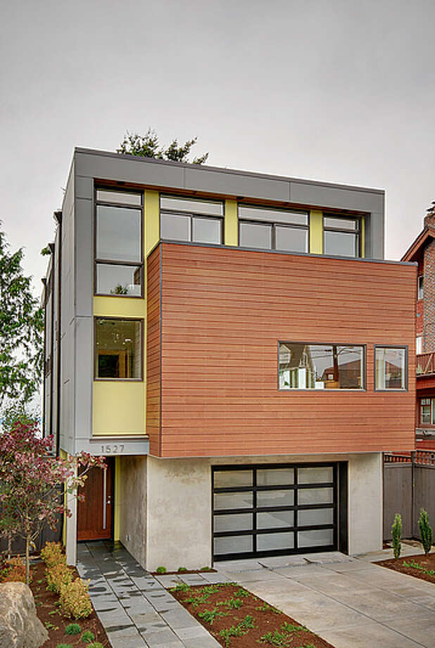 """Contemporary homes generally employ clean lines, open floor plans, big windows, materials such as wood, metal and stone, and latest efficiencies. Here are a few examples built this year and on the market right now in West Seattle, starting with this house at 1527 Sunset Ave. S.W. The 2,850-square-foot house has three bedrooms and 3.5 bathrooms, with white oak cabinets and """"floating"""" stairs, steel railings, quartz countertops, in-floor hydronic heat a heat recovery ventilation system, multiple decks and views of Puget Sound and the Olympic mountains. It's listed for $1.295 million. (Listing: www.pnwrealty.com/pnwra/modules/internet/search/includes/mapsearch/listingpopup.asp?mlsid=101&mlsnumber=260225) Photo: Prudential Northwest Realty Associates"""