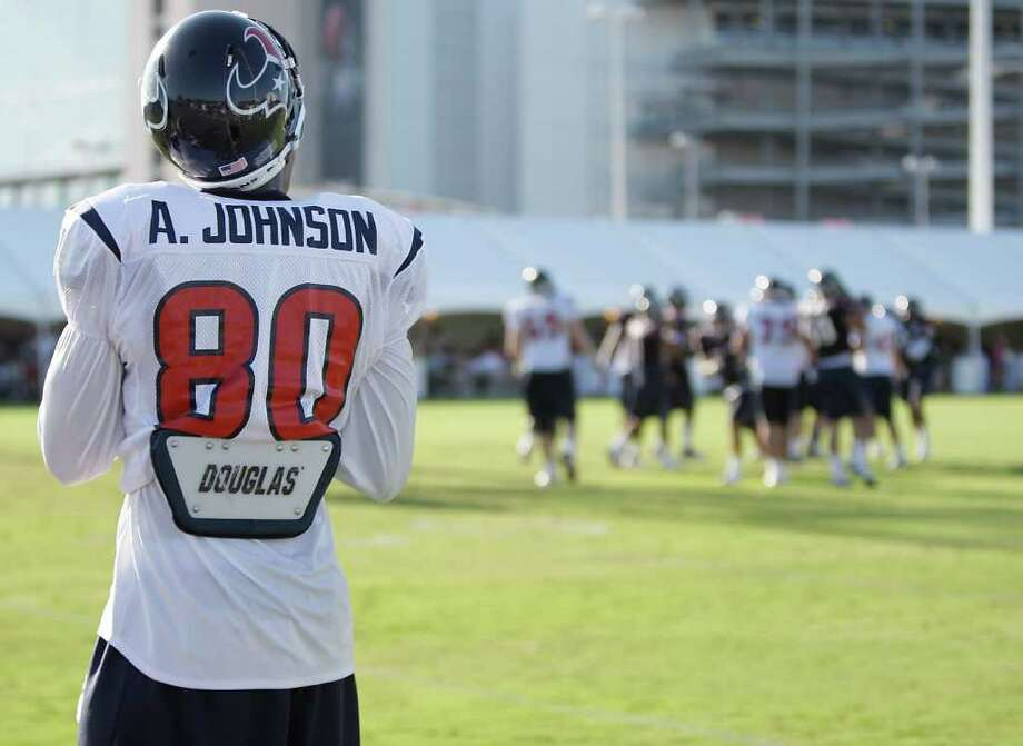 Texans receiver Andre Johnson stands on the sidelines during training camp. Photo: Karen Warren, Houston Chronicle / © 2011 Houston Chronicle