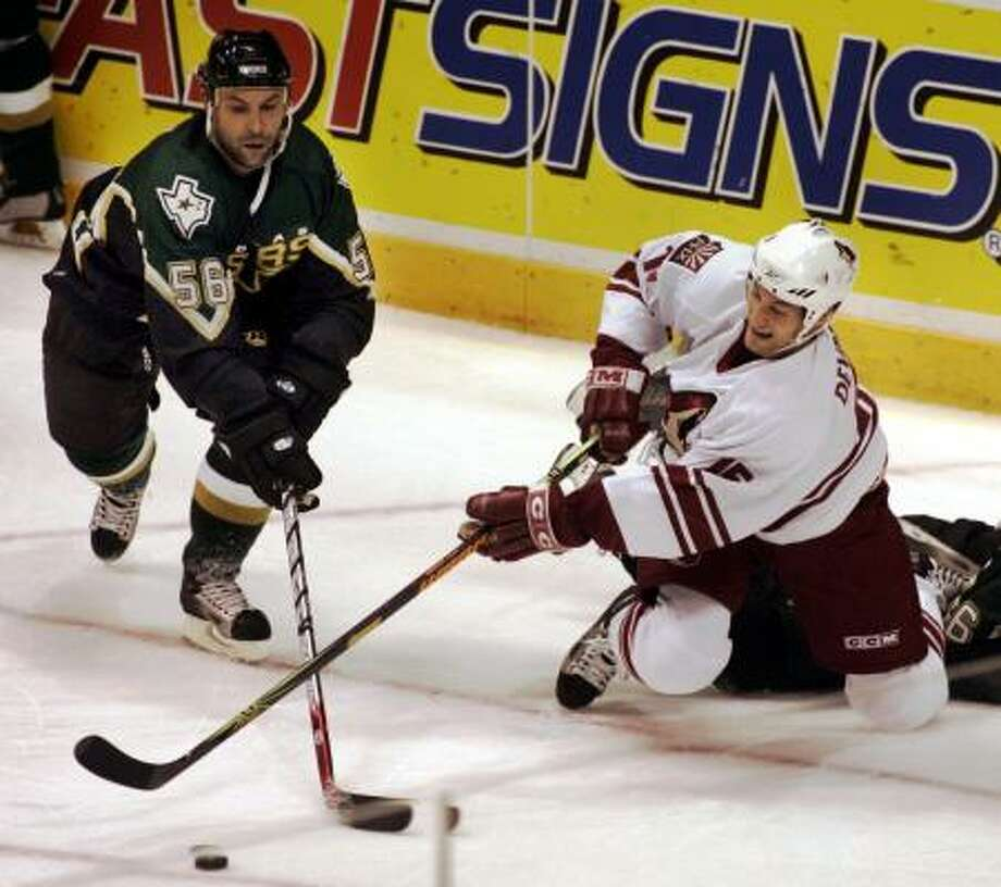 The Dallas Stars and the Phoenix Coyotes will be coming to town in September. Photo: JOHN F. RHODES, AP