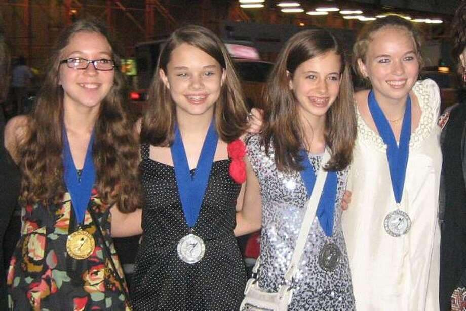 COURTESY PHOTO THEY WENT TO CARNEGIE HALL: Annunciation Orthodox School students Gabriela Tallin, left, Mia Simon, Eleni McGee and Morgan Dickson stand in front of Carnegie Hall after receiving their Scholastic Art and Writing Awards awards. Photo: Courtesy