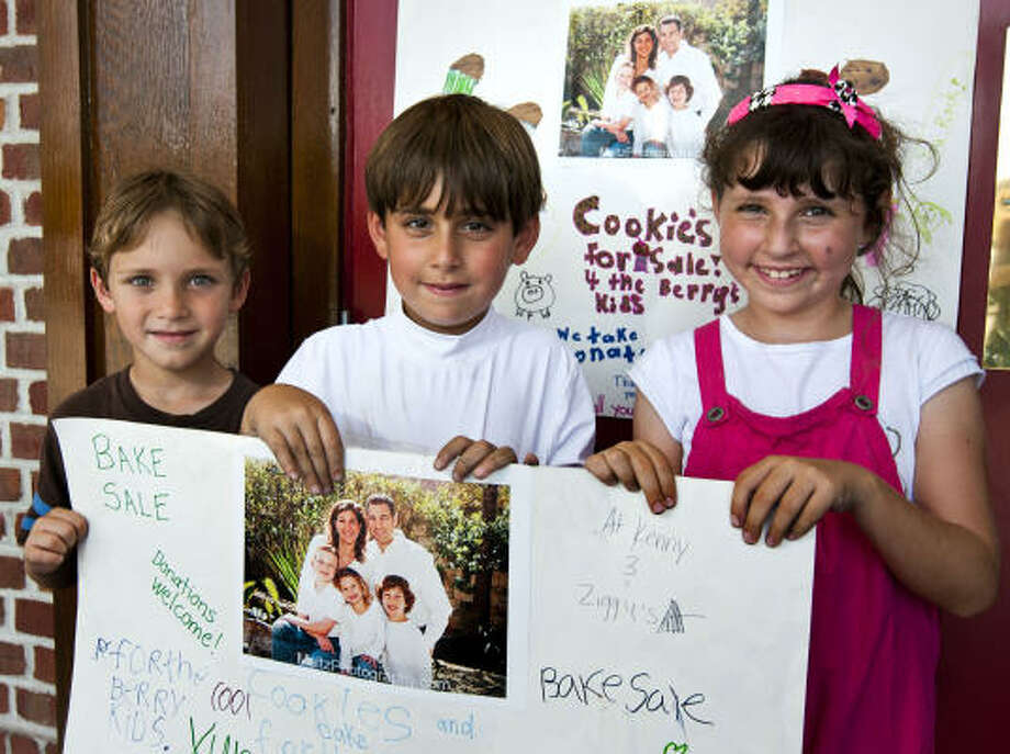 From left, Dylan Kessler, Zachary Harris and Mikayla Kugler hold a sign outside Kenny and Ziggy's New York Delicatessen in Houston encouraging support for a bake sale to help three children who lost their parents in a West Texas crash. Photo: Patrick T Fallon, Houston Chronicle