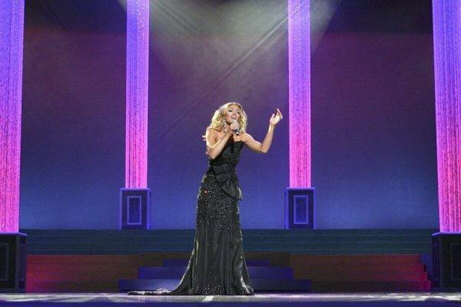 Rachael Turner of Sugar Land sings during the recent Miss Texas Pageant, which was held in Arlington. Photo: Bob Barker, Collagepix.com