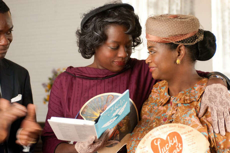In the new movie The Help, Octavia Spencer, right, and Viola Davis appear in classic 1960s outfits. Photo: DISNEY FILMS