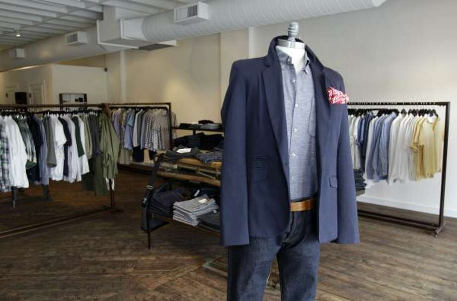 The clothing at Mortar is presented on a handful of simple racks and antique tables that invite casual browsing. Photo: Melissa Phillip, Houston Chronicle