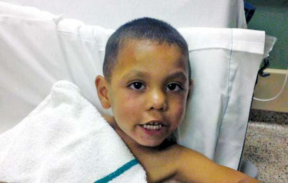 Officers say a passing motorist rescued 4-year-old Angel Flores. Photo: Handout Photo