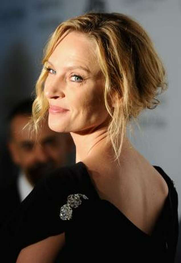 Uma Thurman tucked her sun-kissed ends into a loose up-do, leaving a few tresses to softly frame her face. Photo: Ian Gavan, Getty