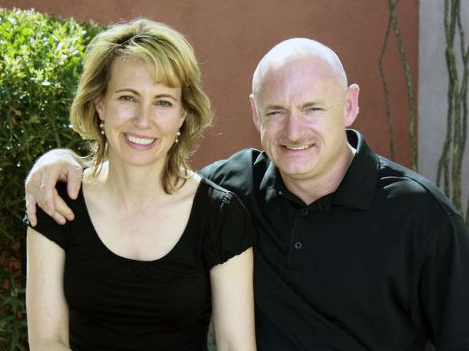 In this undated file photo provided by the office of Rep. Gabrielle Giffords, Giffords, D-Ariz., left, is shown with her husband, NASA astronaut Mark Kelly. Photo: Associated Press