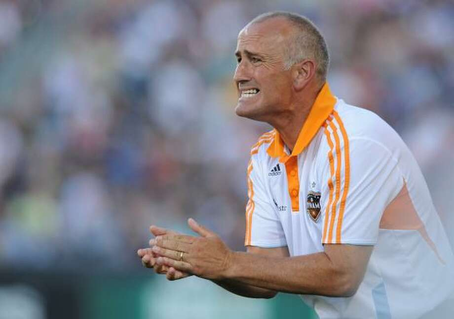 Dynamo coach Dominic Kinnear must weigh the importance of hosting a wild card or resting his key  players Sunday if there's no way they can finish among the top three in  the division. Photo: Bart Young, Getty Images