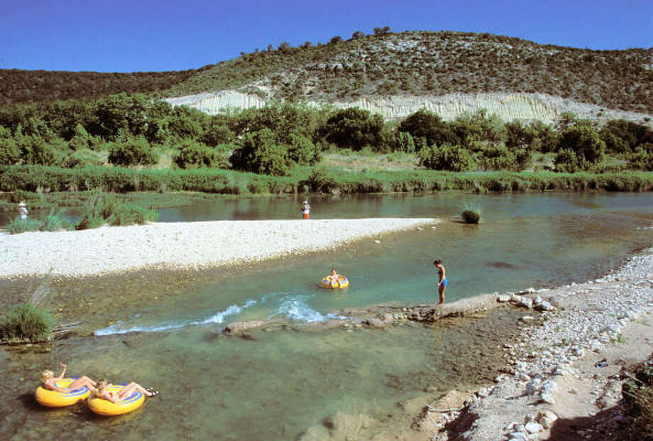 The spring-fed South Llano River near Junction is one of the few Hill Country streams holding enough water for paddling, fishing and other water activities, making South Llano River State Park a popular destination in this dry, hot summer. Photo: Texas Parks & Wildlife