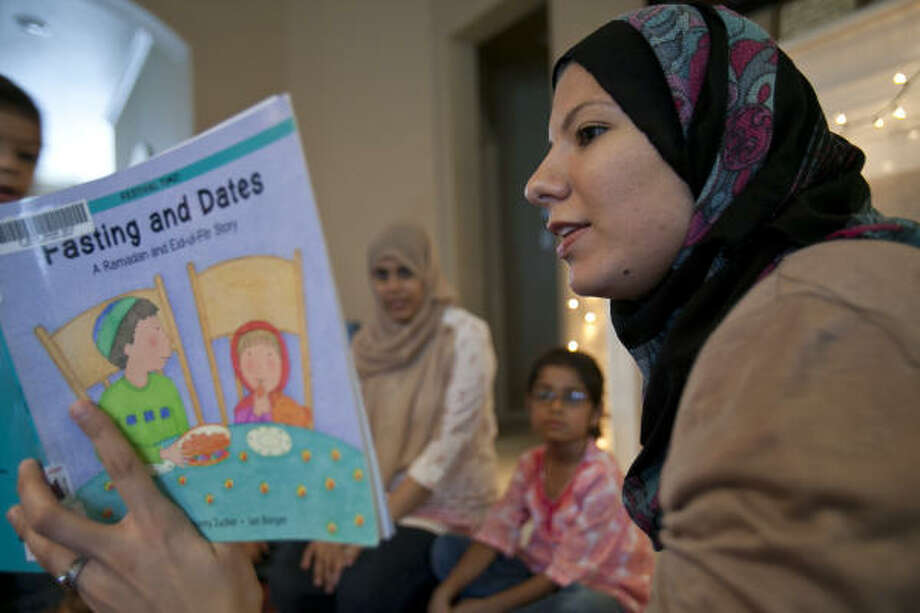 "Shazia Asharaf hosts playdates for young Muslim moms in the area. ""We are more engaged in the learning process with our children. Our parents maybe dropped us off at Sunday school and hoped that we were learning,"" she said. Photo: Nathan Lindstrom Photos"