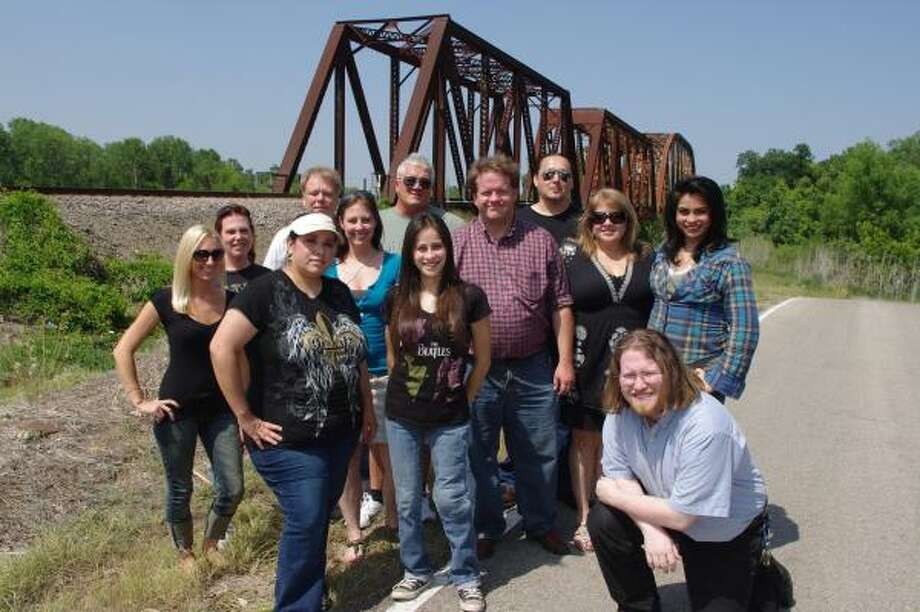 SEARCHING FOR ANSWERS: Kati Vogel, far left, stands with other crew members of One Nation Paranormal.