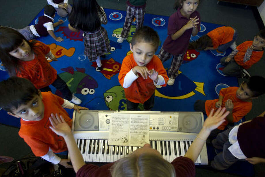 Children learn traditional folk songs at an early age. Photo: Johnny Hanson, Houston Chronicle