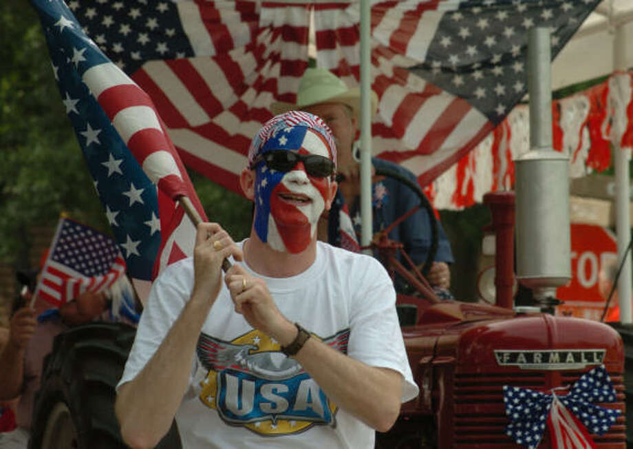 CHRONICLE FILE PARADE TIME: While there will be no fireworks display in The Woodlands this year, an assortment of parades, music and other entertainment will still offer residents a chance to celebrate the Fourth of July. Photo: David Hopper, For The Chronicle