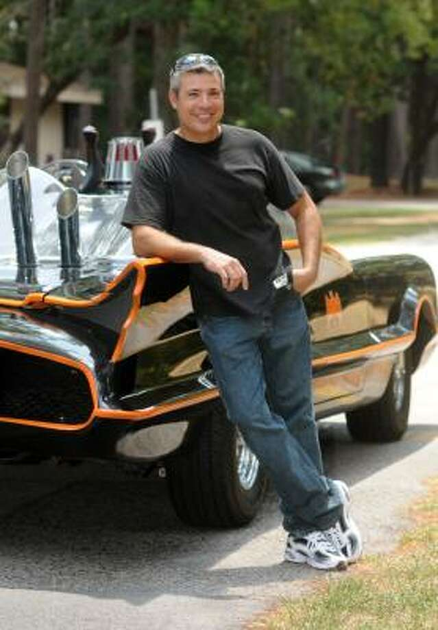 John Salazar, of Kingwood, shows off his 1966 Batmobile. Photo: Jerry Baker, For The Chronicle