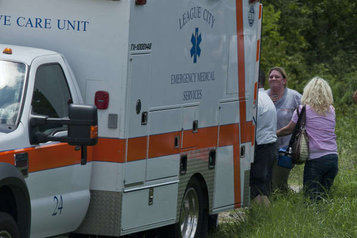Friends and family watch a 25-year-old League City resident, identified as Kevin Gonterman, is transported.