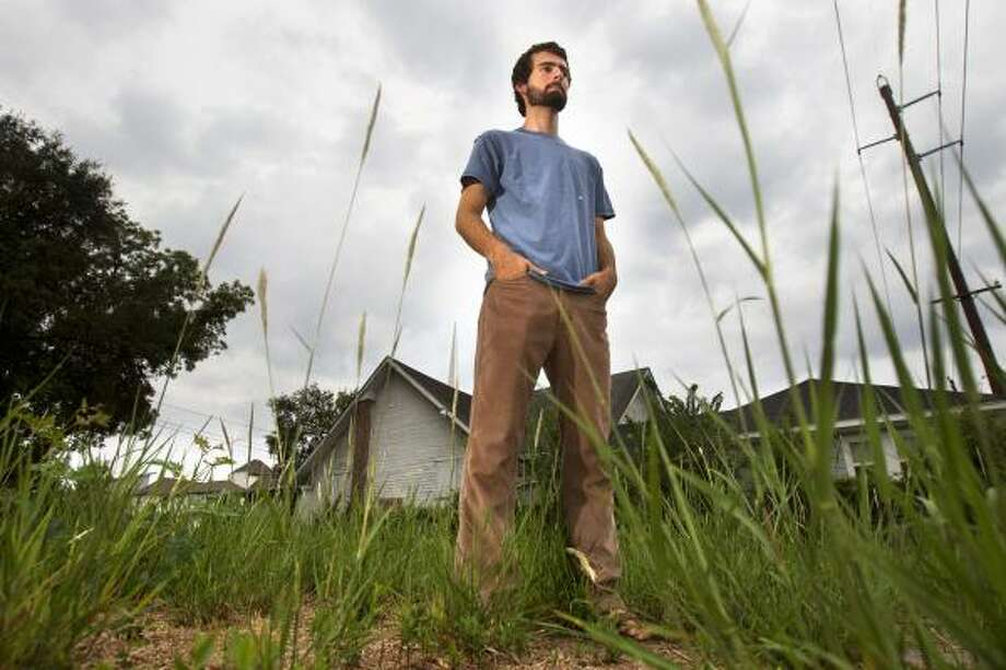 "Matt Gundlach, standing in an abandoned lot in the First Ward, is a member of Mission Year, a program that allows anyone 18 and over to spend a year following Jesus' command to ""Love the Lord your God, and love your neighbor as yourself."" Photo: Cody Duty, Houston Chronicle"