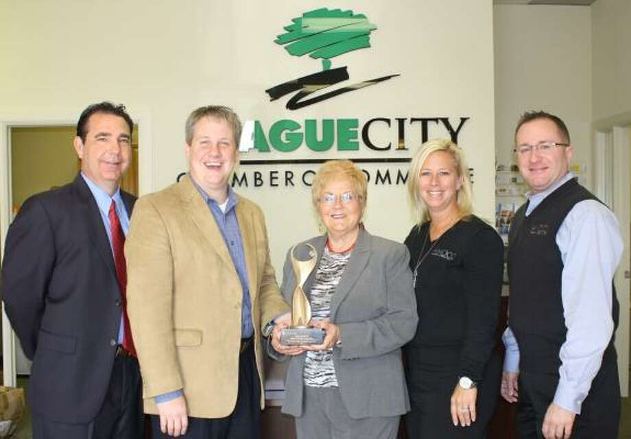 HONORED: League City resident Dee Scott, center, owner of owner of Dee Scott Insurance Agency, is the 2011 ATHENA recipient. Pictured with Scott, are from left, 2011 ATHENA presenting sponsor Shawn Bailey, from left, Marissa Stidham and Kevin Venable of AMOCO Federal Credit Union, and League City Chamber President Jason E. Ebey. LEAGUE CITY CHAMBER OF COMMERCE HONORED: League City resident Dee Scott, center, owner of owner of Dee Scott Insurance Agency, is the 2011 ATHENA recipient. Pictured with Scott, are from left, 2011 ATHENA presenting sponsor Shawn Bailey, from left, Marissa Stidham and Kevin Venable of AMOCO Federal Credit Union, and League City Chamber President Jason E. Ebey. Photo: LEAGUE CITY CHAMBER, ALL