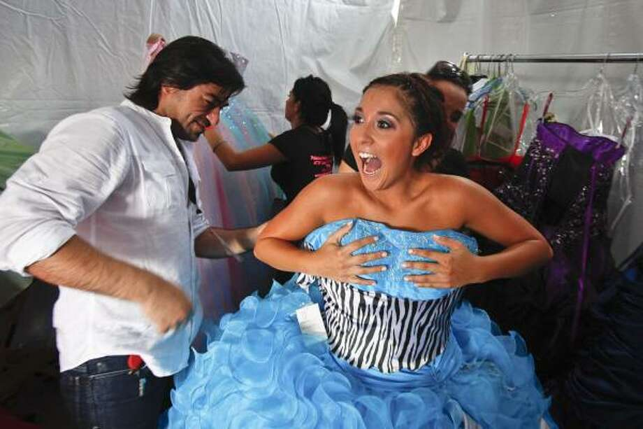 Heather Gonzalez reacts as she hears it's her time to take to the runway as stylist Hugo Longoria preps her during the fashion show at the Verizon My Fabulous Quince Expo. Photo: Michael Paulsen, Houston Chronicle