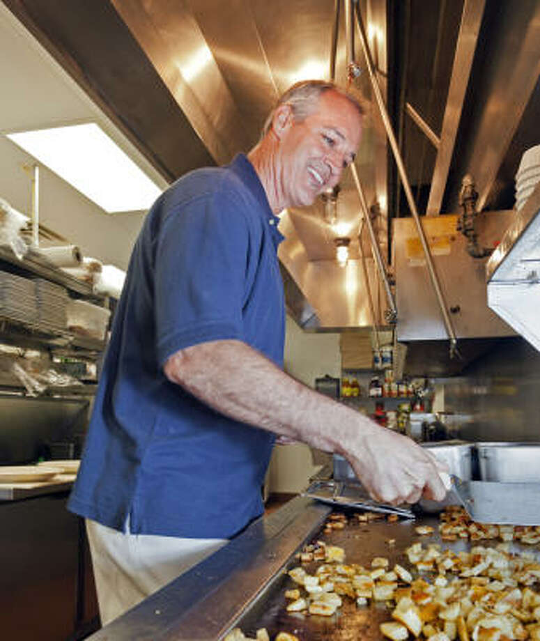 The Egg and I franchisee Chris Osborne, at work at the first restaurant he and his wife opened, in The Woodlands, knows his way around the kitchen. Photo: Craig Hartley, Chronicle