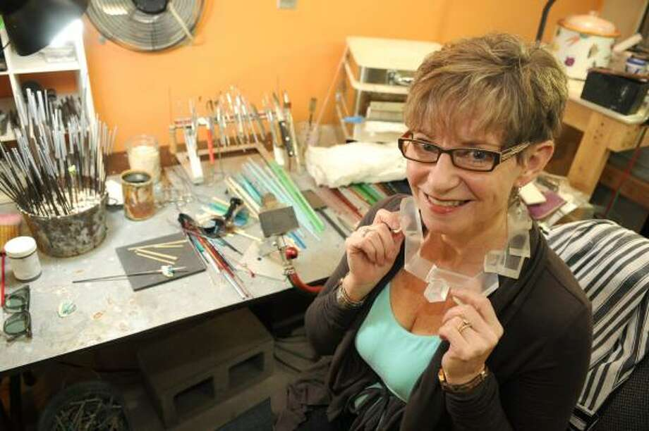 JERRY BAKER: FOR THE CHRONICLE READY TO WEAR: Mary Jarvis shows off an ice neck piece, made from plexiglas and rock crystal, that she created in her studio. Photo: Jerry Baker, For The Chronicle