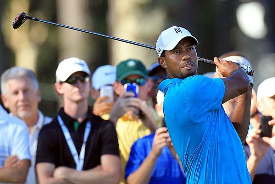Tiger Woods played a practice round Wednesday in advance of the PGA Championship, where some of the competitors he'll face had looked up to him while growing up. Photo: Curtis Compton, McClatchy-Tribune News Service