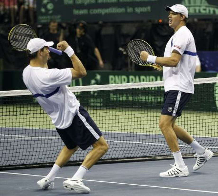 United States' Mike Bryan, left, and Bob Bryan defeated Marcel Granollers and Fernando Verdasco of Spain 6-7 (7), 6-4, 6-4, 6-4 earning the first points for the U.S. in the Davis Cup quarterfinal. The U.S. now has to win the remaining single matches on Sunday to advance. Photo: Eric Gay, Associated Press