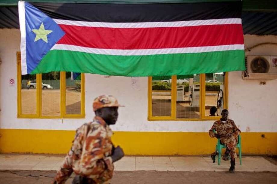Southern Sudanese police forces stand guard in front of a petrol station in the southern capital of Juba on Friday. Photo: Pete Muller, Associated Press