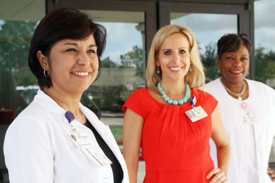 STANDING BY: Pediatric and Adolescent Health Center staff, from left, Dr. Grace Villarreal; Christina Mintner, Harris County Hospital District's director of pediatrics for ambulatory care services; and Jackie Ryan, nurse manager, are ready for patients. The HCHD facility opened June 27. Photo: Pin Lim, For The Chronicle