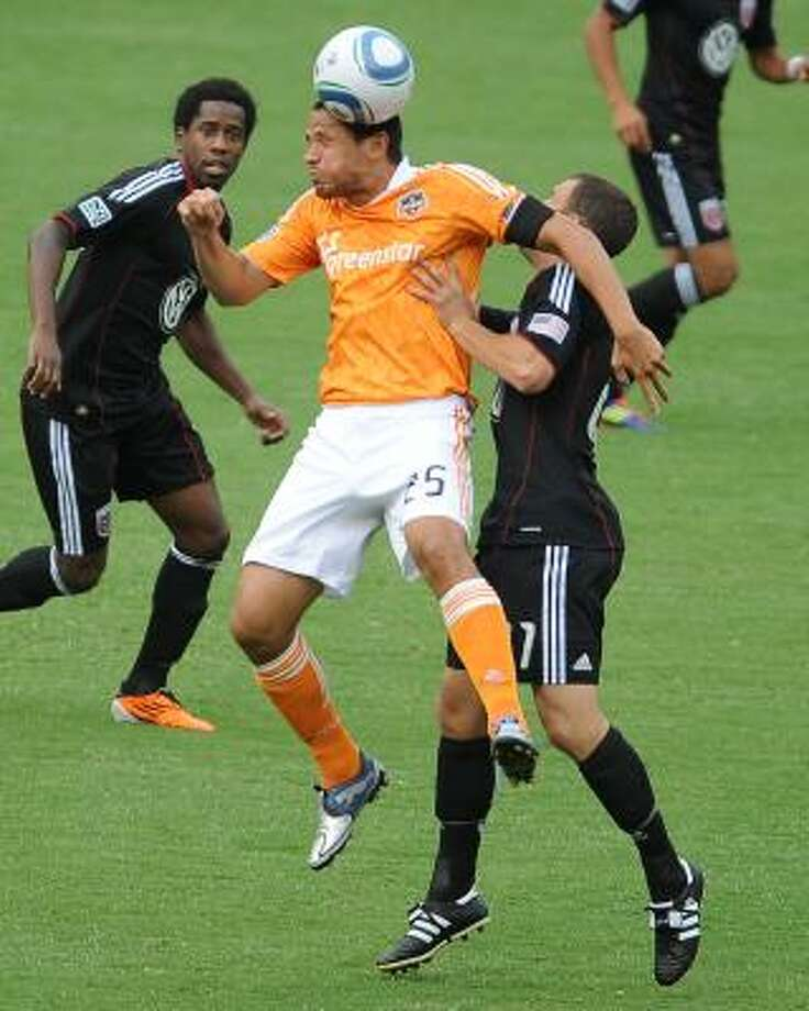 Dynamo forward Brian Ching takes to the air to perform one of the moves that have made him a dangerous scorer in MLS for years. Photo: Chuck Myers, McClatchy-Tribune News Service