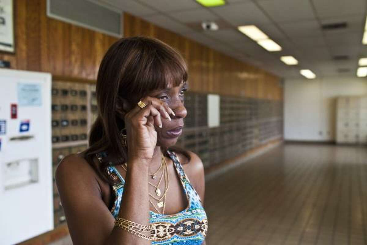 """Mary Wicker, 52, weeps Tuesday after hearing that the Denver Harbor post office, which she said she's been using since the age of 12, might be closed. """"My heart is broken now,"""" she said."""